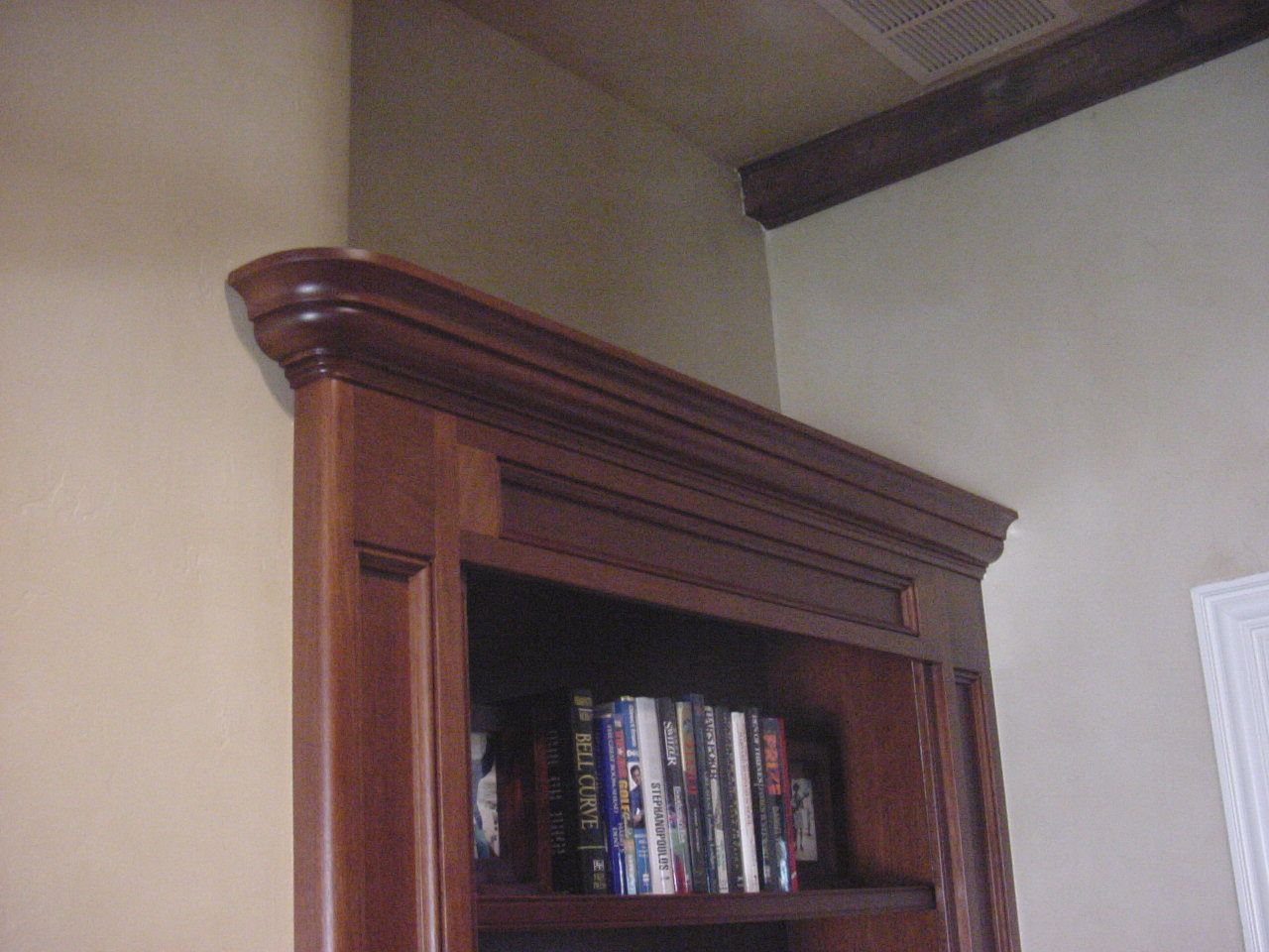 Close up of bookcase top.