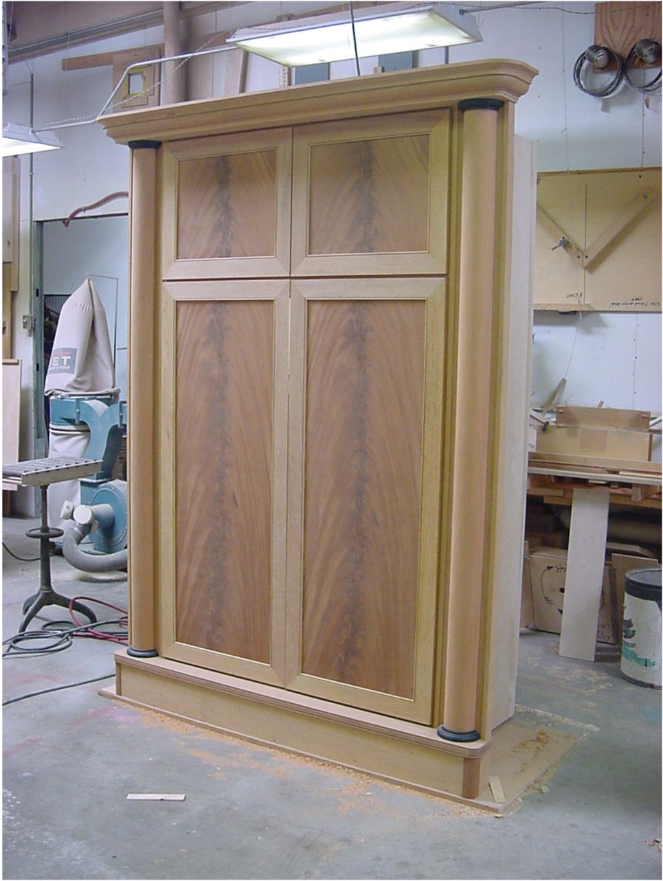 Cabinet in shop complete and unfinished.