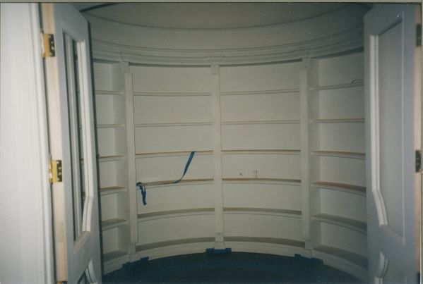 Curved bookcase in round room